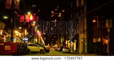 Car parked on street amidst buildings in city at night