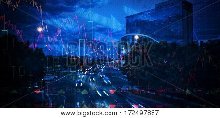 Stocks and shares against cars moving on road in city at night