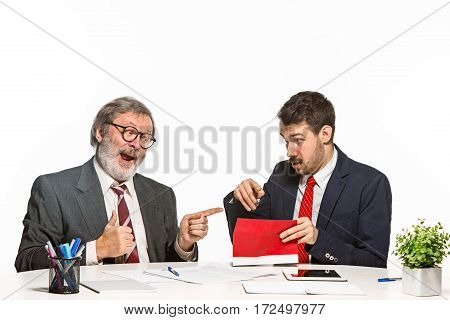 Concept - corruption. Businessman in a suit taking a bribe at office on white studio background.