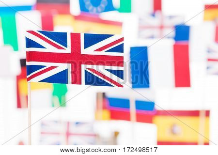 Picture of small paper flag of Great Britain against flags of European Union member-states