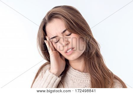 charming young woman with a headache isolated on white background