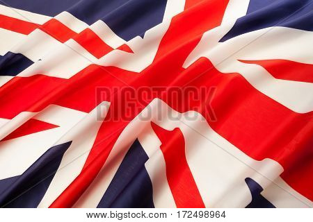 Full framed waving national flag of Great Britain close-up of center cross