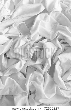 Closeup of rippled white silk fabric Closeup of rippled white silk fabric
