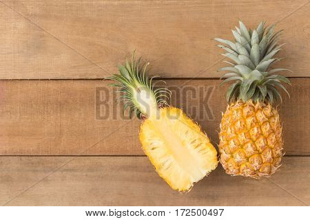 half pineapple on wood table top view
