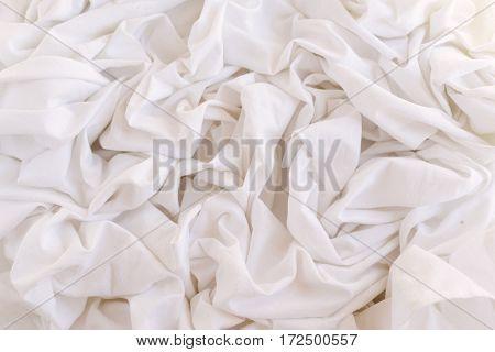 Closeup of rippled white silk fabric Closeup of rippled white silk fabric
