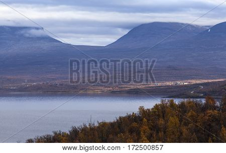 Nordic mountains in overcast weather, autumn fall. Well known landmark in northern Sweden along the road Narvik - Kiruna. Abisko in the sunlight.
