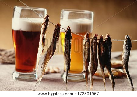 Dried fish and beer on the table