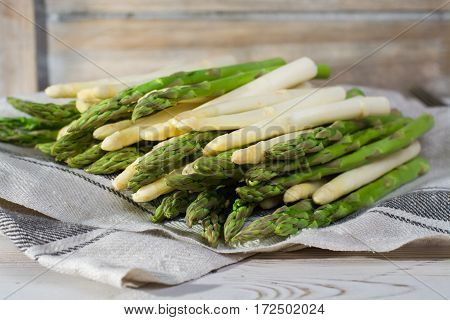 Spring season diet meal - fresh white and green asparagus on linen napkin