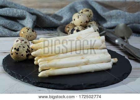 Spring season diet meal - fresh white asparagus and quail eggs