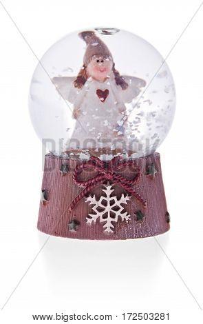 Snow Globe With Angel On A Ceramic Base.