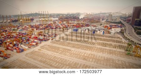Aerial view of cargo containers at commercial dock blur