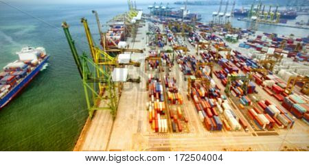 Aerial view of cargo containers by sea at commercial dock