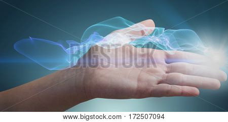 Close-up of cropped woman hand against blue glowing black background