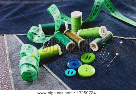 set of needlework objects on jeans background