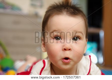 Surprised baby girl infant close up portrait