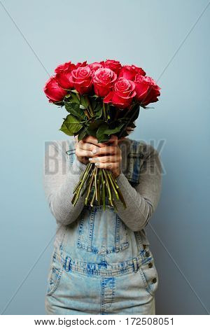 Girl with bouquet of flowers in her hands. Flowers, Spring, Romance, March 8. Bouquet of roses