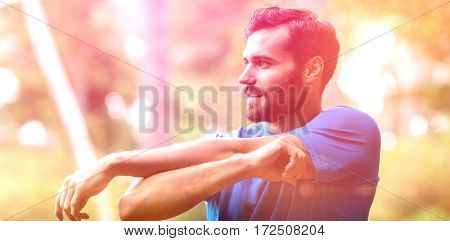 Smiling man exercising in forest