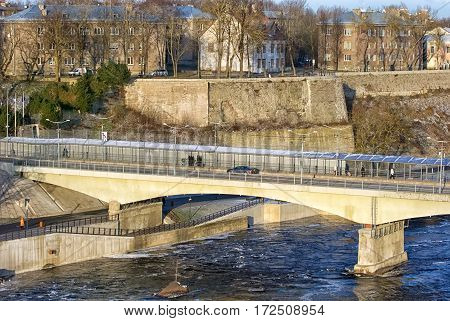 NARVA, ESTONIA - JANUARY 3, 2017: Bridge of Friendship with pedestrian tunnel over Narova River between Narva in Estonia and Ivangorod in Russia. Here is the border of two countries. View from Russia