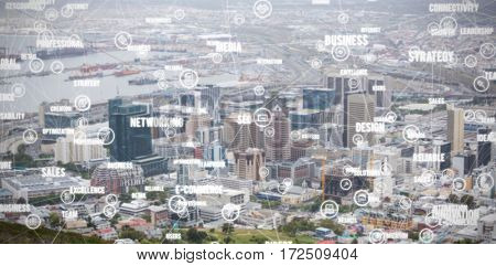Sphere of icons and words against view of crowded cityscape Aerial view of crowded cityscape