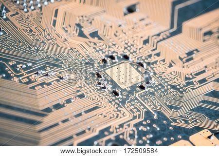 closeup of the golden electronic circuit board