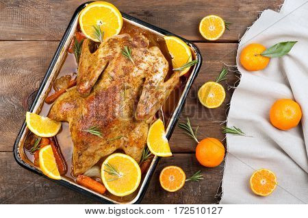 Roasted chicken / duck with vegetables, citrus and rosemary. Christmas festive table. Thanksgiving dinner. Top view