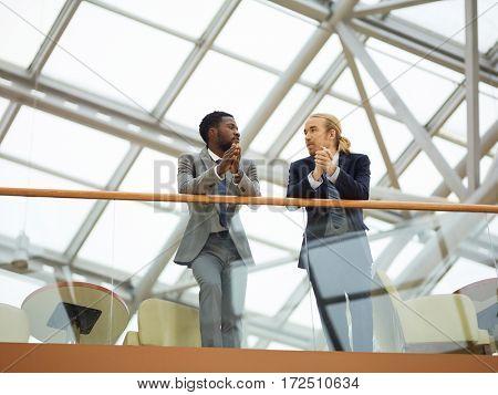 Young multi-ethnic entrepreneurs talking at meeting