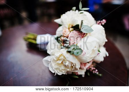 Elegance Wedding Bouquet Of White And Rose Peonies At Wooden Table.