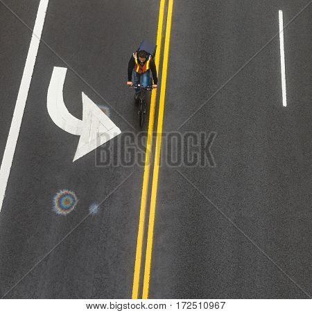 NEW YORK USA - May 03 2016: Road markings on asphalt on the street of Manhattan in New York City. Сyclist moves along the road. Iridescent spot of gasoline on asphalt