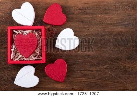 Hearts background. Gift box with heart. Valentines Day card. Top view
