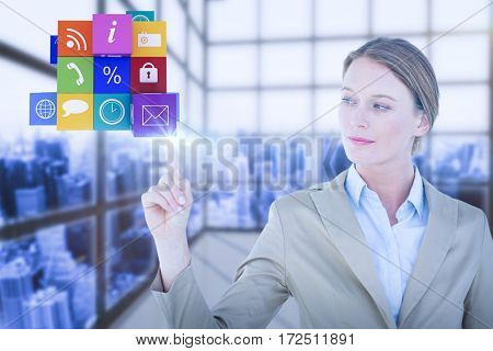 Businesswoman pointing cube with her finger against room with a lot of windows