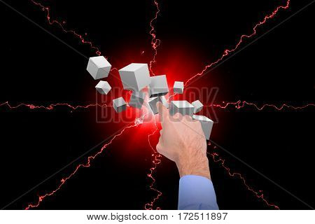 Businessman hand pointing against digitally generated grey cubes floating