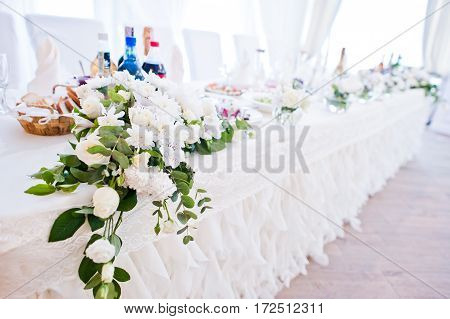 Flowers Decor On Table Of Newlyweds At Wedding Hall.