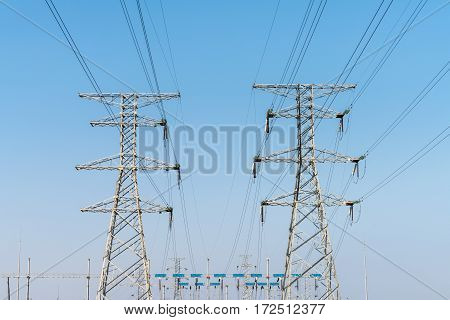 electricity transmission pylon with a blue sky