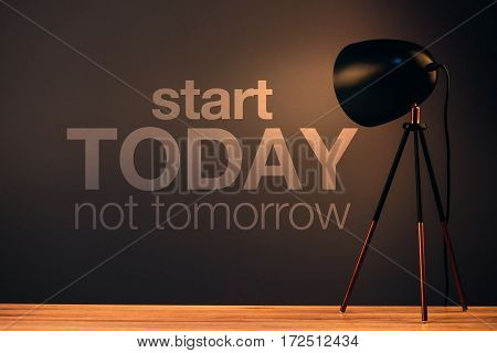 Start today not tomorrow motivational quote on office wall