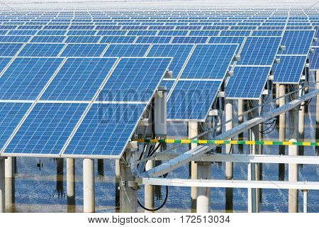 solar panels closeup in pond power plant using renewable energy