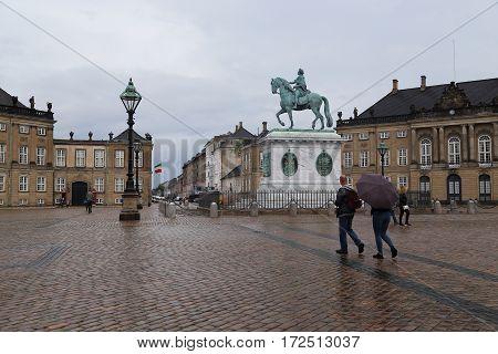 COPENHAGEN, DENMARK - JUNE 29, 2016: It is Amalienborg Castle Square and The equestrian statue Frederik V.