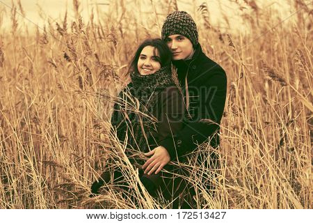 Happy young couple in love walking on nature. Stylish fashion model outdoor