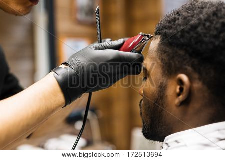 Client of hairstylist being served in barbershop