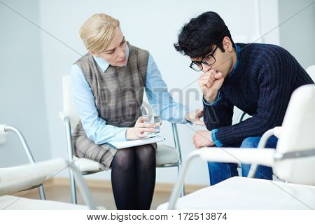 Young man visiting counselor in times of trouble