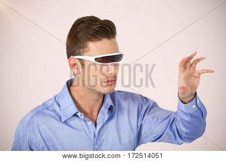 Man gesturing while using virtual video glasses against white background