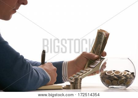Accountant or banker calculating balance. finances investment economy saving money or insurance concept.