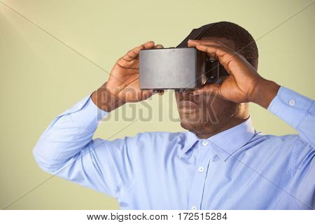 Man holding virtual reality headset against white background