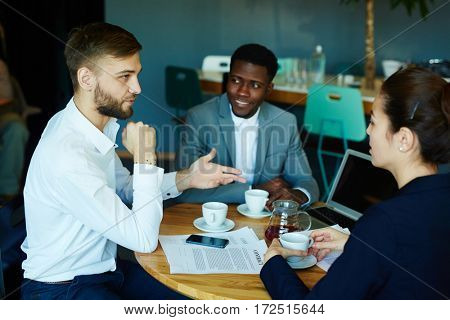Businessman talking to one of candidates for new vacancy