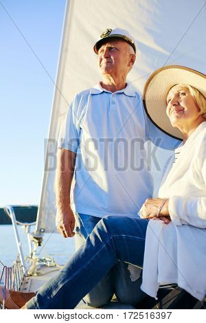Serene pensioners enjoying their voyage on yacht