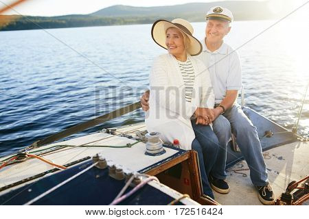 Restful senior couple having voyage on yacht