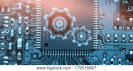 Cog and wheel against blue electronic circuit