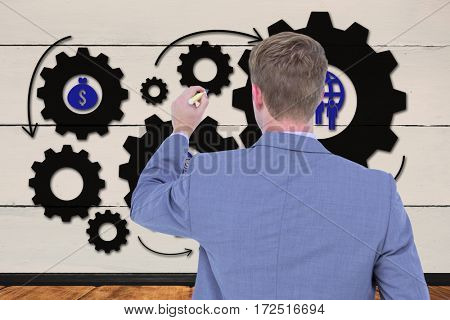 Businessman writing on a white background against a wall