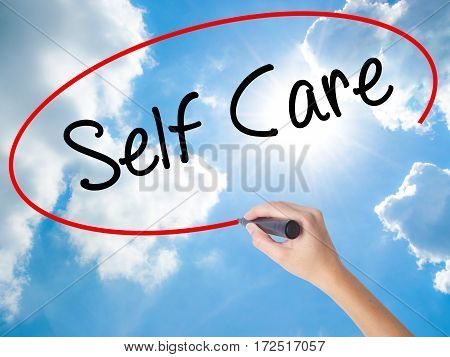 Woman Hand Writing Self Care With Black Marker On Visual Screen