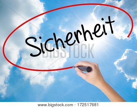 Woman Hand Writing Sicherheit (safety In German) With Black Marker On Visual Screen