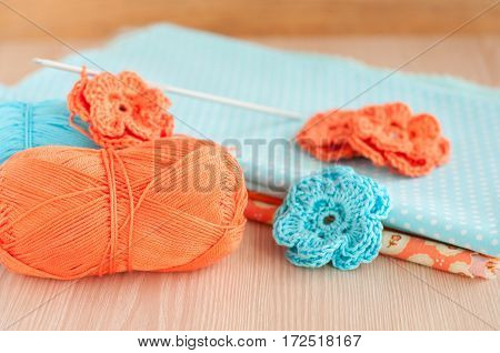 Handmade knitted crochet flowers. Cotton textile for needlework. Selective focus